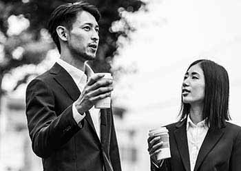 Businessman and businesswoman talking